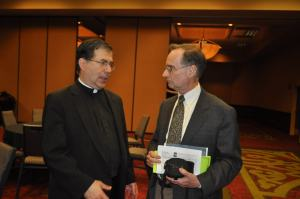 Quiner talks with Fr. Frank Pavone